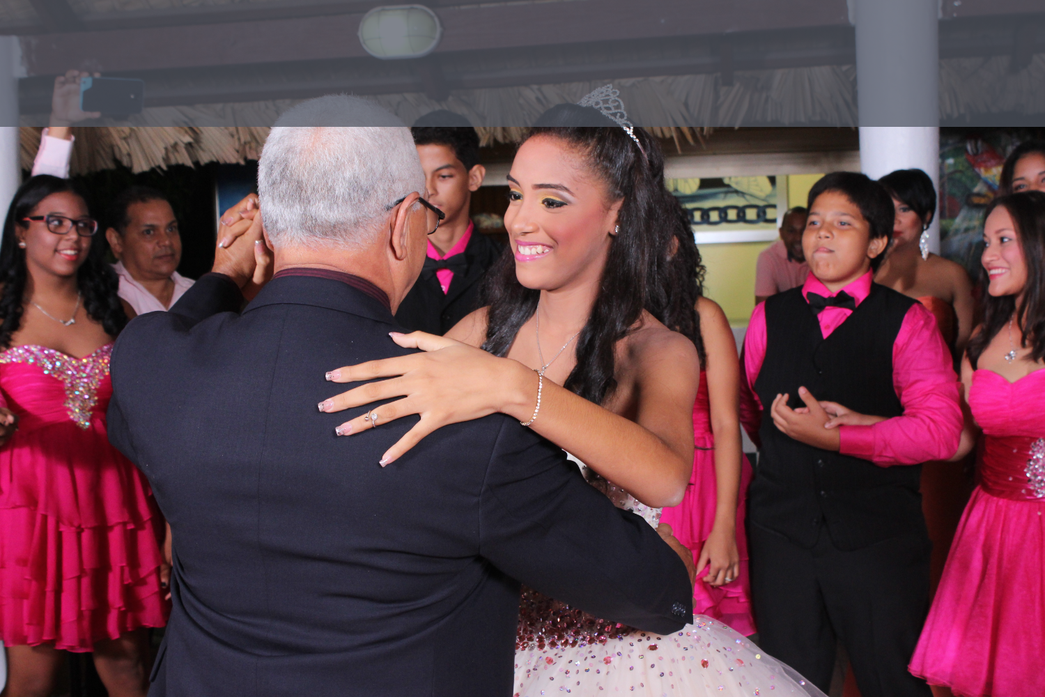 A Quinceañera dancing with daddy